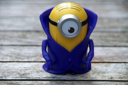 Almere, Flevoland, The Netherlands - July 14, 2015: Vampire Minion McDonalds Happy Meal toy against a wooden background