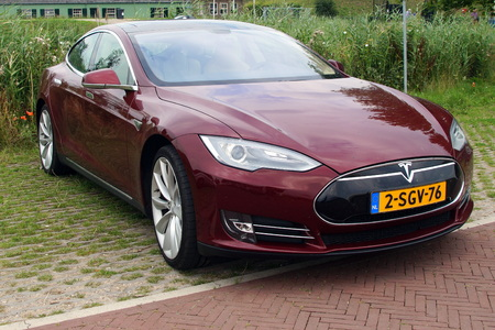 new motor car: Multi-coat Red Tesla Motors Model S - Front view