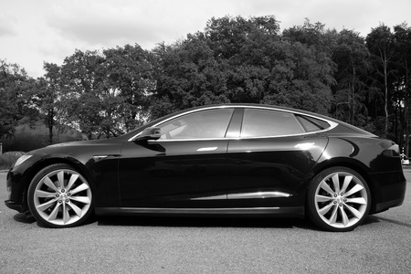 new motor vehicles: Black Tesla Motors Model S - sideview blacknwhite Editorial