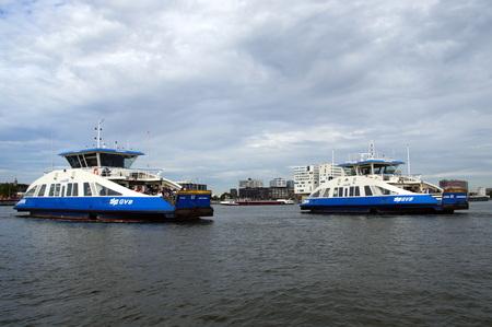 ferries: Two Dutch CFP Passenger Ferries crossing Ij river - Amsterdam