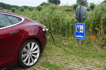breaking new ground: Red Tesla Model S being charged