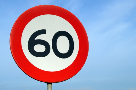 60: Only 60 Road Sign - Age of sixty - left Stock Photo