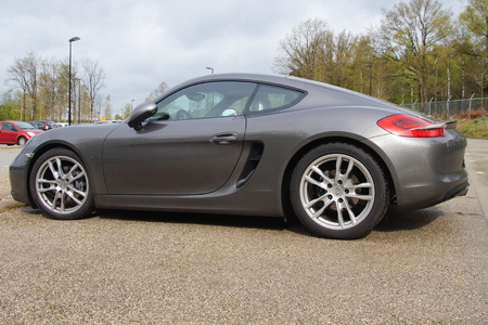 cayman: Gray Porsche 981 Cayman coupe - side back view