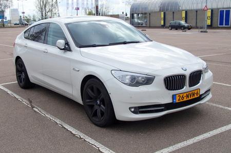 upper class: White BMW GT sedan