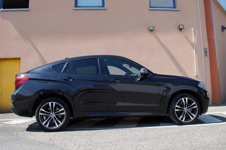 upper class: Black BMW X6 - sideview