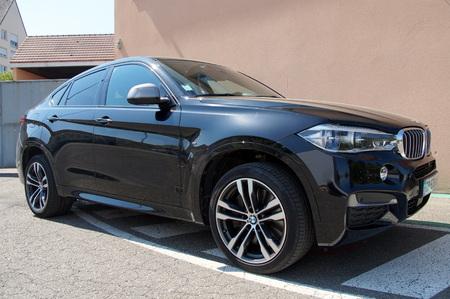 upper class: Black BMW X6 Editorial