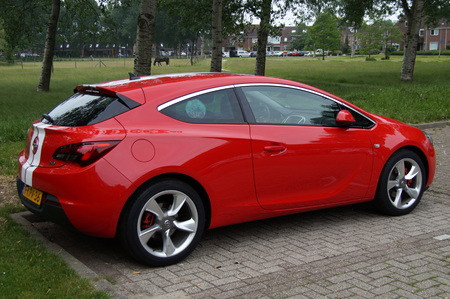 Red Opel Astra GTC - backside view