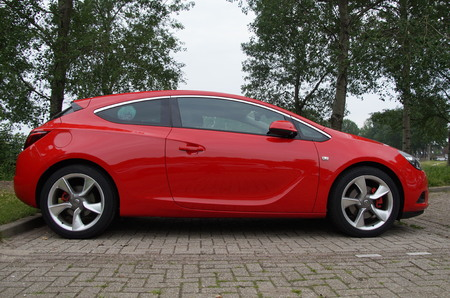astra: Red Opel Astra GTC - sideview Editorial