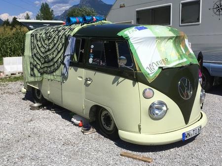 Green and White Volkswagen (VW) Transporter Type 1 Camper