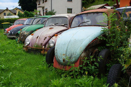 Old rusting abandoned Volkswagen Beetles