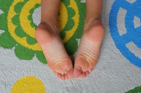 Child sleeping on a playing carpet - childhood 写真素材