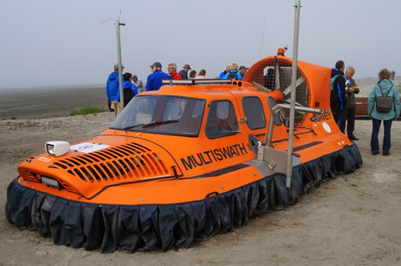 Orange Burnham-On-Sea BBV-6 Hovercraft with unidentified people on a foggy day. BBV (Bill Baker Vehicles) built its first hovercraft in 1973. Editorial