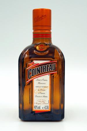 Bottle of Cointreau triple sec (an orange-flavored) liqueur Redactioneel