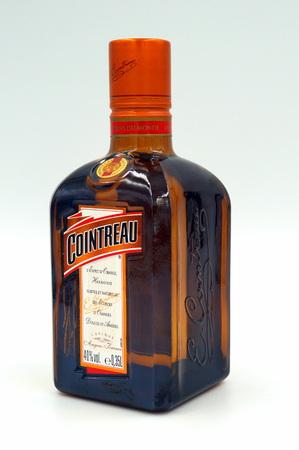 Bottle of Cointreau triple sec (an orange-flavored) liqueur Редакционное