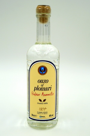 Bottle of famous Greek spirit Ouzo Plomari Isidoros from Arvanitis Distillery.