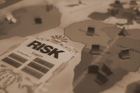 Risk board game black and white (selective focus closeup)