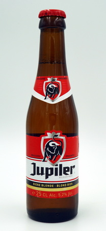 Bottle of Jupiler beer. Jupiler is a pale lager styled beer brewed by Brasserie Piedboeuf (InBev) in Jupille-sur-Meuse, Belgium. Editorial