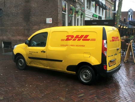 DHL delivery car Editorial