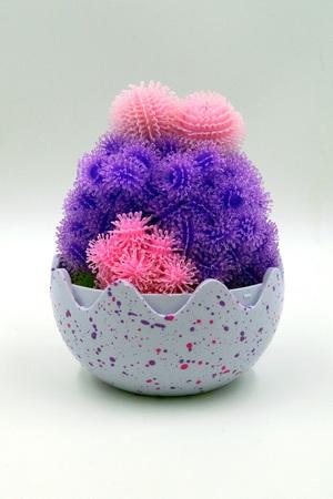 Open Bunchems Hatchimals pengola surprise egg against a white background.
