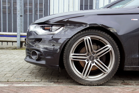 Front of a Audi a6 with damage.