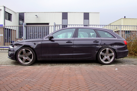 Audi a6 avant with damage parked by the side of the road. Nobody in the vehicle.
