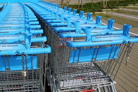 Row of blue Albert Heijn shopping carts or trolleys. Albert Heijn is the largest Dutch supermarket chain.