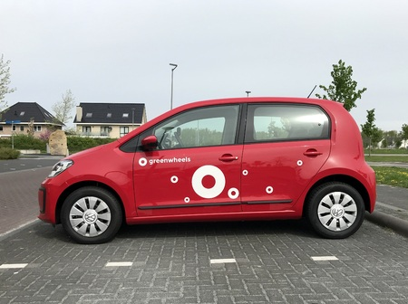 Red Volkswagen Up from Greenwheels, the largest car-sharing corporation in the Netherlands and also operates in Germany.