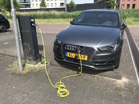 Almere, Netherlands - May 27, 2018: Audi A3 Sportback E-Tron electric car at a Allego charge point.