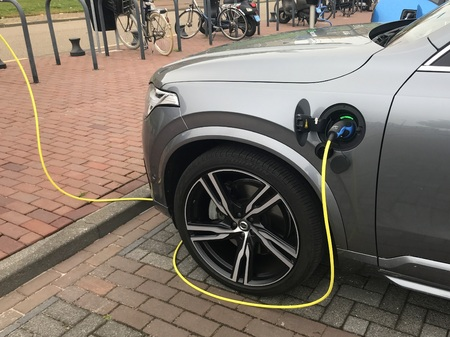 Lelystad, Netherlands - June 3, 2018: Volvo XC 90 electric car being charged at a charging point.