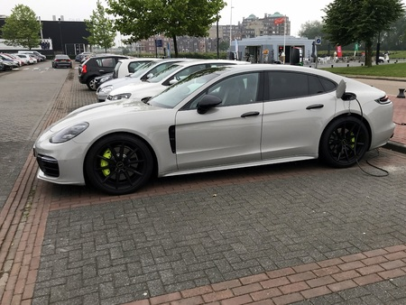 Lelystad, Netherlands - June 3, 2018: Porsche Panamera 4 electric car being charged at a charging point.