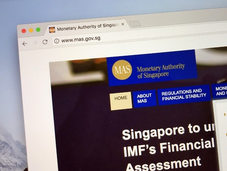 Amsterdam, the Netherlands - August 24, 2018: Website of The Monetary Authority of Singapore, Singapore's central bank and financial regulatory authority.