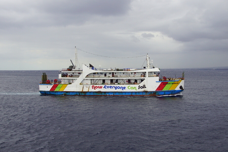 Kalipuro, Java, Indonesia - August 5, 2018: 'Now Everyone Can Sail' written on the side of a ferry boat between Java and Bali, Indonesia. Editorial