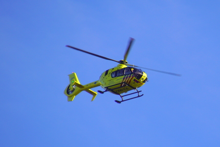 Almere, Netherlands - October 5, 2018: Dutch Ambulance Helicopter (Lifeliner 1) flying by against a clear blue sky. Sajtókép
