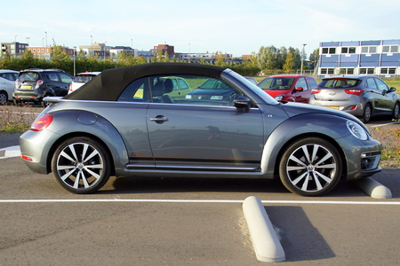 Almere, Netherlands - October 12, 2018: Gray Volkswagen New Beetle cabriolet parked on a public parking lot. Nobody in the vehicle.
