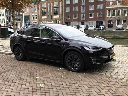 Dordrecht, the Netherlands - October 25, 2018: Tesla model X parked by the side of the road. Nobody in the vehicle.