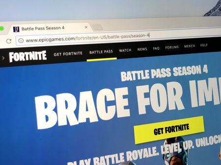 Amsterdam, The Netherlands - May 9, 2018: Official homepage of Fortnite season 4, a production of Epic Games. Epic Games, Inc. is an American video game and software development corporation. Editorial