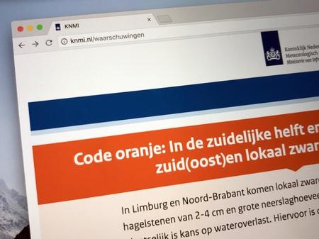 De Bilt, Netherlands - May 27, 2018: Website of The Royal Netherlands Meteorological Institute (Dutch: Royal Dutch Meteorological Institute or KNMI, issuing a code orange weather warning.