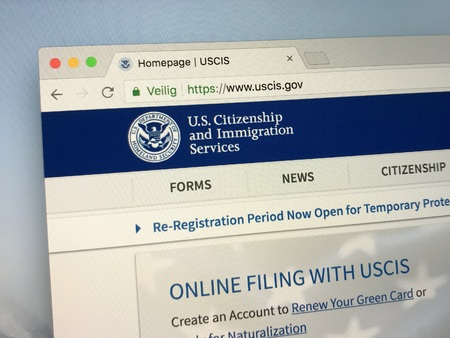 Amsterdam, Netherlands - June 14, 2018: Official American government website of US Citizenship and Immigration Services or USCIS.