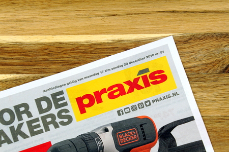 Amsterdam, the Netherlands - December 16, 2018: Hardware store sale flyer or advertising brochure, or Dutch Hardware store chain Praxis against a wooden background. Standard-Bild - 113749808