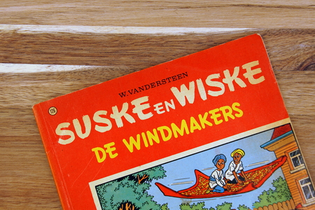 Amsterdam, the Netherlands - December 22, 2018: Comic book cover or Suske en Wiske, a Belgian comics series, against a wooden background.