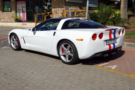 Puerto Rico de Gran Canaria, Spain - January 1, 2019: White Chevrolet Corvette 2dr Coupe parked by the side of the road. Nobody in the vehicle. 報道画像