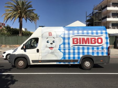 Maspalomas, Gran Canaria, Spain - January 4, 2019: Bimbo delivery of, and unknown and unrecognizable driver, passing by on public road in the Spanish city of Maspalomas.