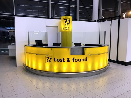 Schiphol, the Netherlands - January 5, 2019: Yellow lost and found counter at Amsterdam Airport Schiphol. Editorial