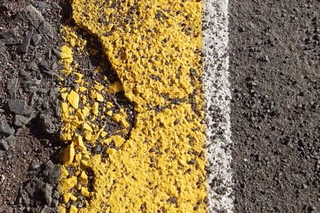 Damaged yellow asphalt lining - Closeup Reklamní fotografie