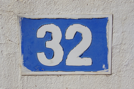 House number thirty two - 32 Stock Photo