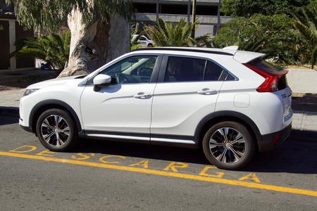 ogan, Spain - December 31, 2018: White Mitsubishi Eclipse Cross SUV parked on a parking lot intended for loading  unloading. Redakční