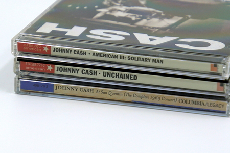 Amsterdam, The Netherlands - February 8, 2019: Compact Disc (CD) Albums from American singer-songwriter and guitarist Johnny Cash.