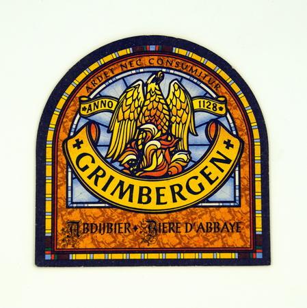 Amsterdam, the Netherlands - February 19, 2019: Grimbergen beer coaster.