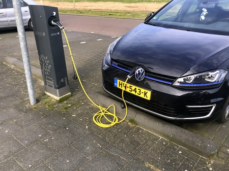 Almere, the Netherlands - February 20, 2019: Electric Volkswagen Golf at a Allego charge point. Sajtókép