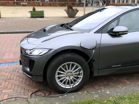 Almere, the Netherlands - March 1, 2019: Gray Electric Jaguar I-Pace being charged. Sajtókép